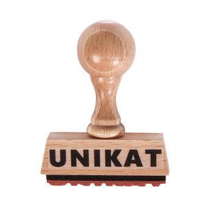 Houten stempel met tekst 'Unikat'